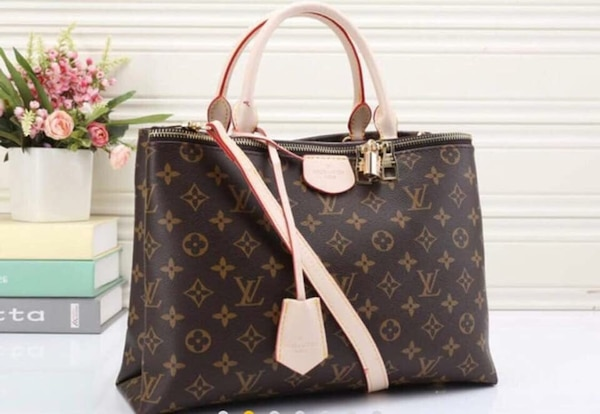3ee2c99bc29e Used black and brown Louis Vuitton monogram tote bag for sale in Kingston