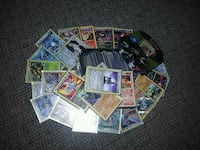 Pokemon cards with sleeves and Tin