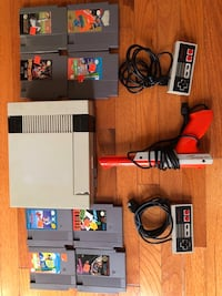 Nintendo NES console with controllers,Nintendo zapper and game cartridges Herndon, 20170