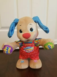 beige, red, and blue dog plush toy