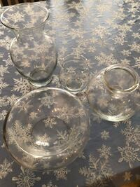 4 glass candle vases