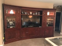 brown wooden TV hutch and flat screen TV Pompano Beach, 33069