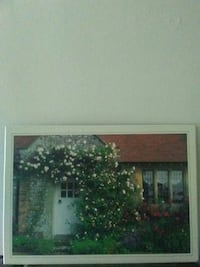 brown and red house near garden photograph with white frame London, N6A 2T9