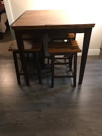 Rectangular brown wooden table with four chairs dining set New Westminster, V3M