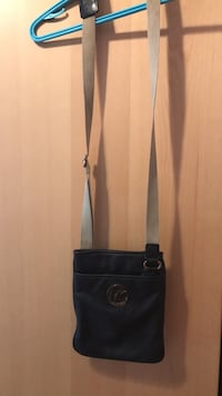 black leather crossbody bag with tassel Montréal, H3N 2P1