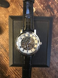Skeleton face watch with black leather strap Hamilton, L9B 1C2