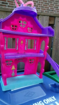 pink and purple plastic dollhouse