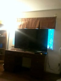 black flat screen TV with brown wooden TV stand Penn Valley, 95946