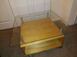 Glass and wood tv stand / coffee table like new