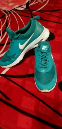 pair of teal Nike running shoes Placentia, 92870