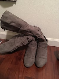 pair of gray leather 2-buckle riding boots