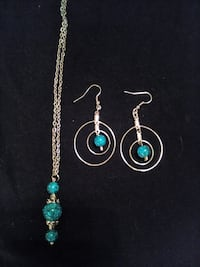 silver-colroed and blue gemstone hooked earrings and pendant necklace