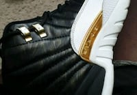 paired white and black adidas low-top sneaker East Point, 30344