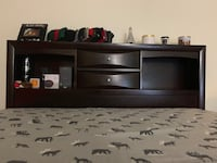 black wooden TV stand with flat screen television Anaheim, 92806