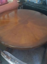 round brown wooden table with chairs Glendale, 85310