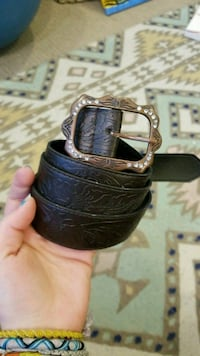 copper-colored buckle black leather belt