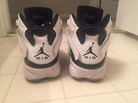 Pair of white-and-black nike basketball shoes Diberville, 39540