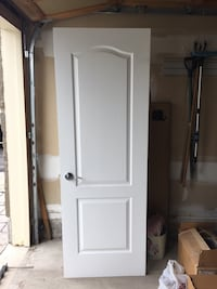 """White wooden 2-panel door complete with door handles and hinges. 28""""x 80"""". If you are facing the door it swings in to the right Vaughan, L6A 0E8"""
