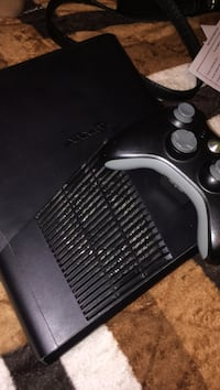 Black xbox 360 console with black controller