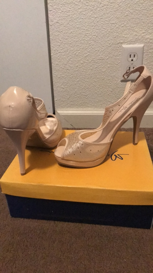 Pair of women's champagne colored pumps