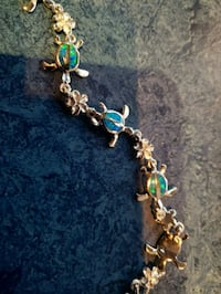 gold-colored and blue beaded bracelet Alexandria, 22312