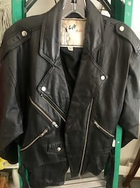Black leather motorcycle jacket zipper's galore size large women's it's really nice Henderson, 89012