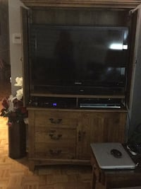 black flat screen TV and brown wooden TV hutch Mississauga, L5M 6P8