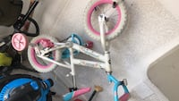 white and pink BMX bike 646 mi