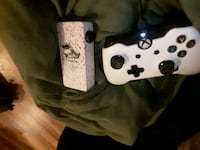 white and black Xbox One controller