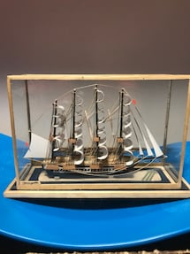 Small wood/glass cased ship made in cuba