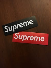 two black and red Supreme stickers Winnipeg, R3J 1R3