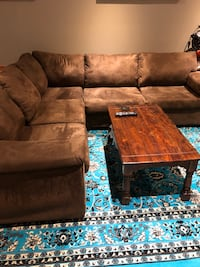 brown suede sectional sofa with throw pillows Toronto, M3H 6A1