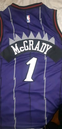 Toronto Raptors throwback purple T-Mac jersey.