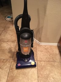 black and gray Bissell upright vacuum cleaner Collinsville, 74021