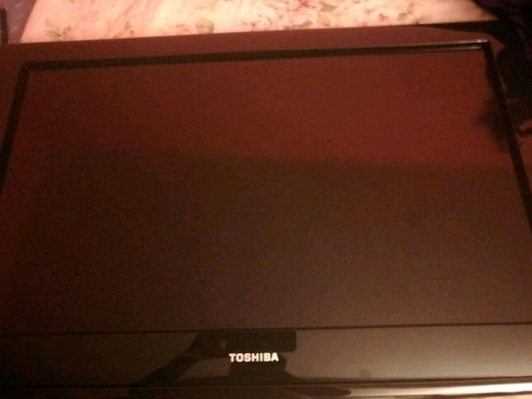 black Toshiba flat screen TV