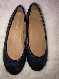 pair of black leather flats Rochester, 14612