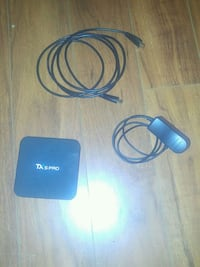 Black android box with power chord and  cable and  Vancouver, V5N 1Y9