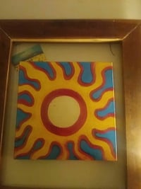 painting of yellow and red sun