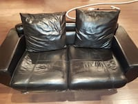 Black leather loveseat and sofa with chrome legs. Vaughan