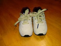 pair of white-and-black Nike basketball shoes 763 mi