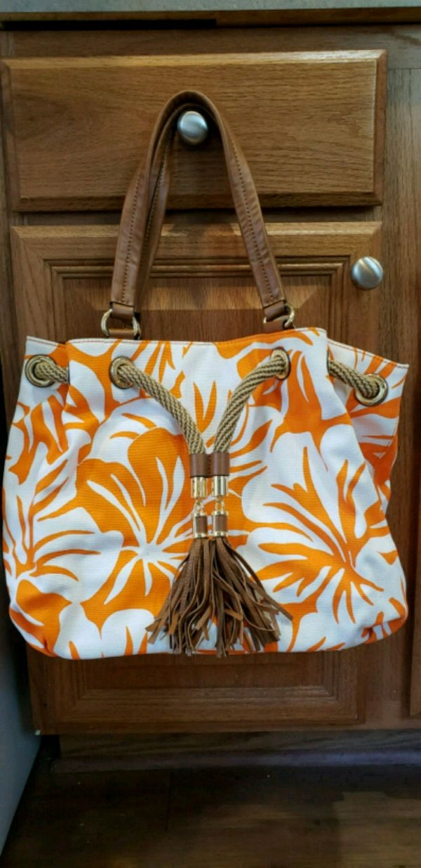 white and red floral leather tote bag