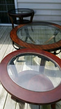 round brown wooden framed glass top coffee table Bowie, 20720