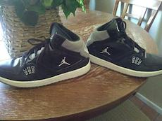 pair of black-and-white Air Jordan sneakers