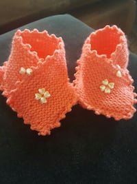 2 Orange gestrickten Textilien