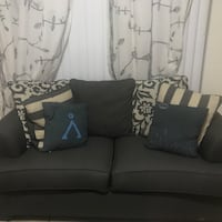 gray fabric 3-seat sofa with throw pillows