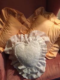 Accent pillows. Two peach and one lace heart shape