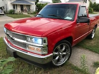 Red Chevy Single cab pickup truck
