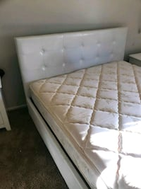 brown wooden bed frame with white mattress 1816 mi