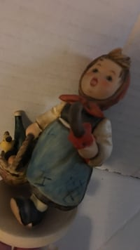 Brown haired woman ceramic figurine