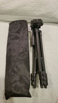Lightweight camera tripod with bag.